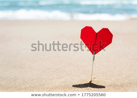 red origami heart on the beach with blank space Stock photo © nito