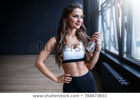 beautiful black woman with water after exercise stock photo © darrinhenry