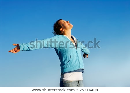 Happy teen girl with outstretched arms Stock photo © palangsi
