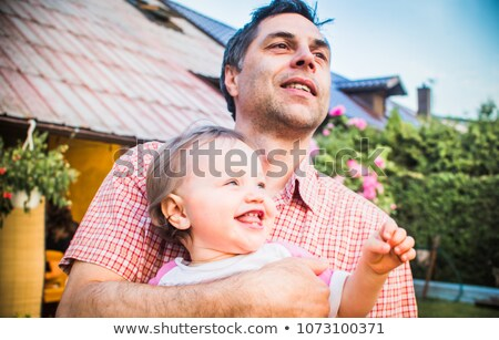 closeup portrait of old man and his daughter stock photo © hasloo