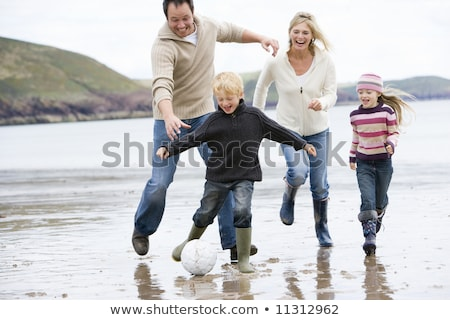 Happy family of five having outdoors and playing soccer Stock photo © get4net