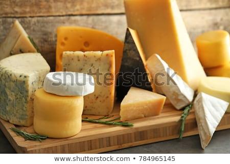 Appétissant fromages pièces alimentaire lumière fond Photo stock © ozaiachin