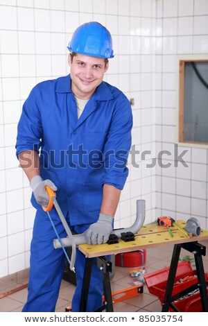 young workman sawing plastic pipe stock photo © photography33