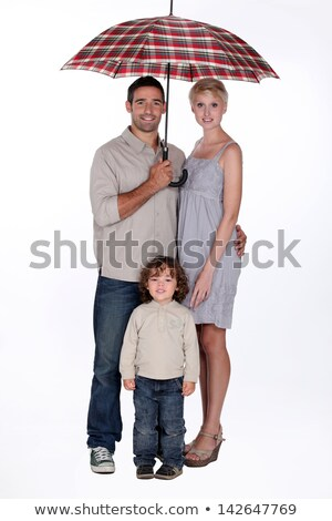 Young family standing underneath an open umbrella Stock photo © photography33