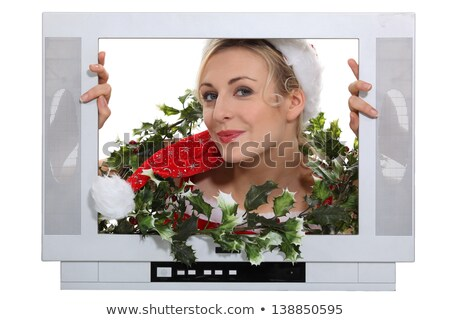 Woman in festive outfit escaping from television Stock photo © photography33