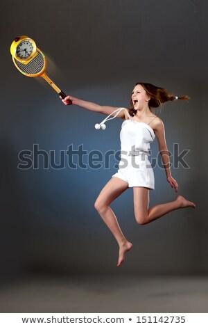 girl jumps up and hits the alarm clock stock photo © utorro