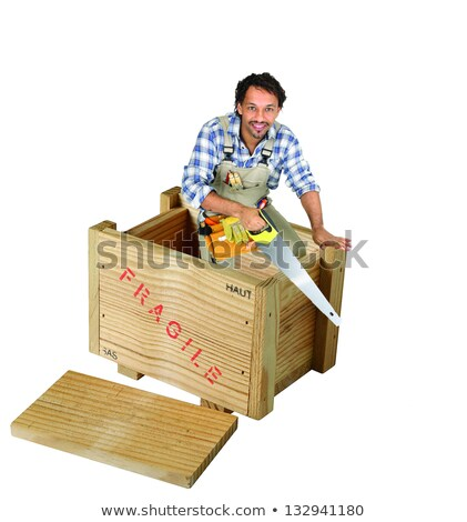 carpenter with saw stood in wooden box stock photo © photography33
