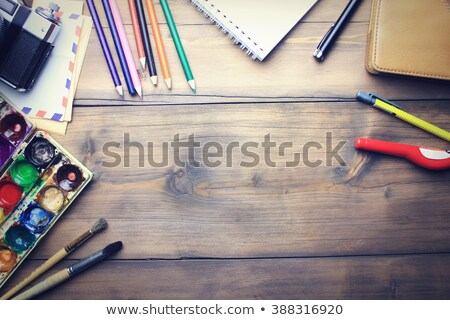 Set of art paints and brushes to paint and paper on wooden table Stock photo © inxti