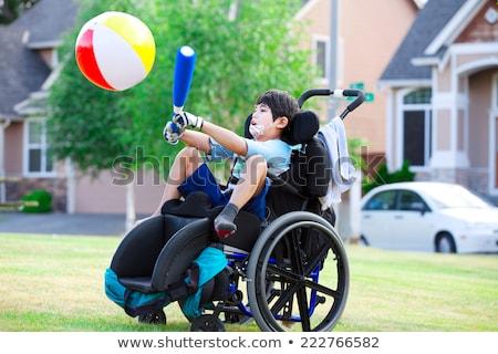 Disabled boy on handicap swing Stock photo © jarenwicklund