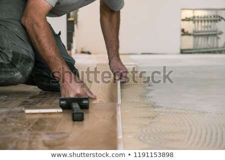 Carpenter sawing wooden flooring Stock photo © photography33