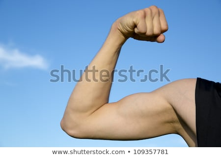 Sportsman show its muscles when strain hand stock photo © vetdoctor
