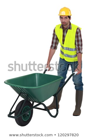 Unfriendly labourer pushing a wheelbarrow Stock photo © photography33