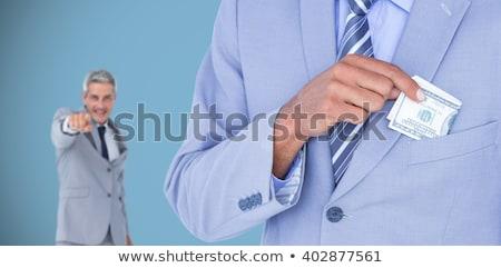 Mosolyog üzletember bemutat bankjegyek fehér üzlet Stock fotó © wavebreak_media