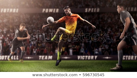 soccer player hits the ball Stock photo © mayboro1964