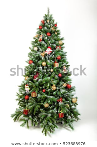 Gyönyörű díszített karácsonyfa gyertyák íj zöld Stock fotó © tannjuska