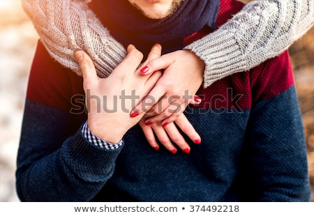 passionate couple holding hands and standing embraced stock photo © feedough