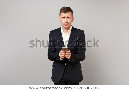 Stock photo: Bewildered businessman reading a text message
