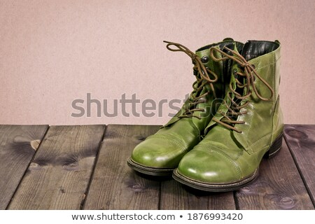 Pair of old boots on wooden floor boards Stock photo © lucielang