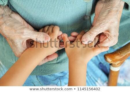 Abuela nieto mano sesión jardín familia Foto stock © meinzahn