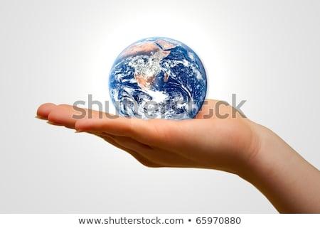 Hands gently holding a globe. Stock photo © m_pavlov