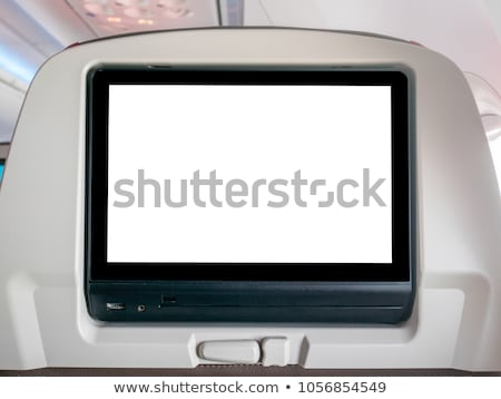 Blank screen on the back of an airplane seat Stock photo © bmonteny