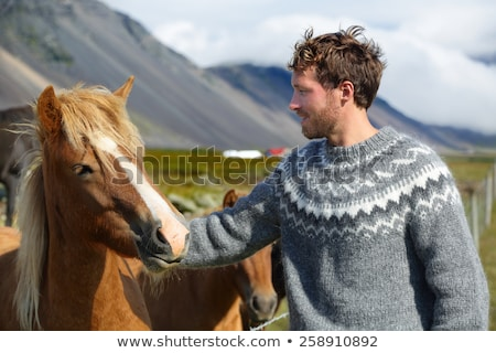 Handsome man in Icelandic sweater outdoor Stock photo © Maridav