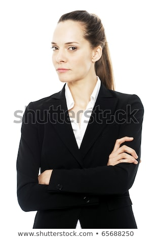Severe businesswoman with arms crossed on white background studio Stock photo © ambro