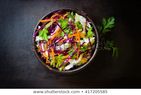 Salad from fresh vegetables, sliced cabbage and carrots Stock photo © Tatik22