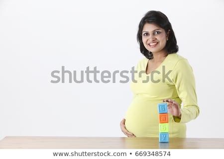 grávida · barriga · blocos · menina · bebê · mulheres - foto stock © konradbak