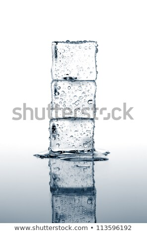 stack of three ice cubes on white background stock photo © shawnhempel