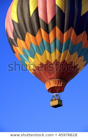 Hot air balloon launching against a blue sky Stock photo © Balefire9