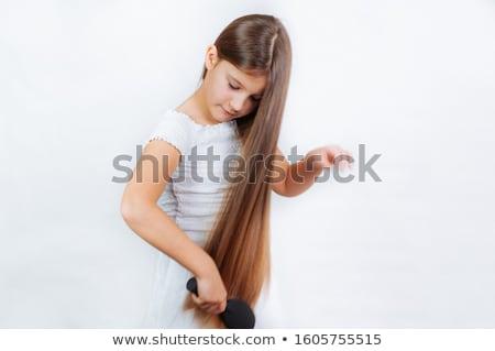 Attractive girl with long hair Stock photo © oleanderstudio