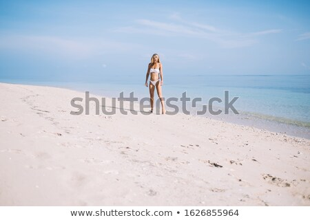 young woman stands ashore of sea Stock photo © Paha_L