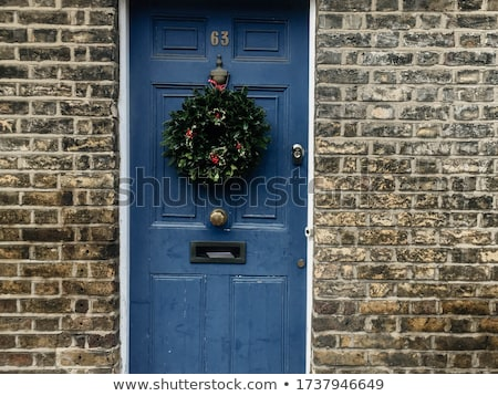 christmas wreath hanging on door stock photo © smuki
