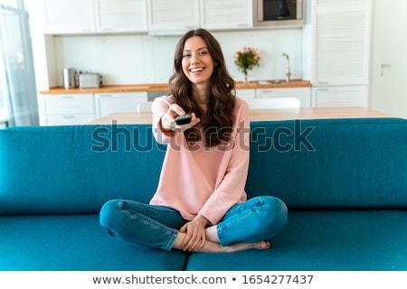 Donna seduta soggiorno controllo Foto d'archivio © deandrobot