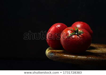 Fresh vegetables on dark wooden table. Stock photo © rrvachov