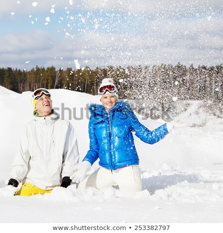 Two Friends Sitting Together on Sunny Ski Hill Stock photo © dash
