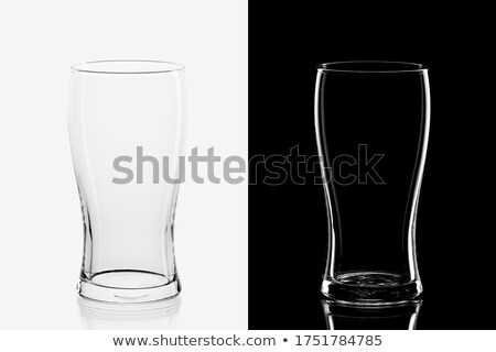 glass of beer on the black and white background stock photo © capturelight