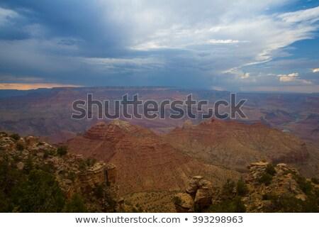 Famoso Grand Canyon pesado tempestade pôr do sol natureza Foto stock © CaptureLight