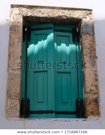 traditional greek stone house blue gate and window shutters santorini island greece stock photo © photocreo