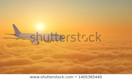 wing of airplane flying above clouds blue sky background stock photo © frameangel