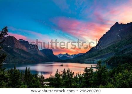 Sunset over a mountain at lake stock photo © Yongkiet