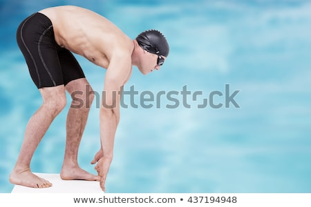 Composite image of swimmer ready to dive Stock photo © wavebreak_media