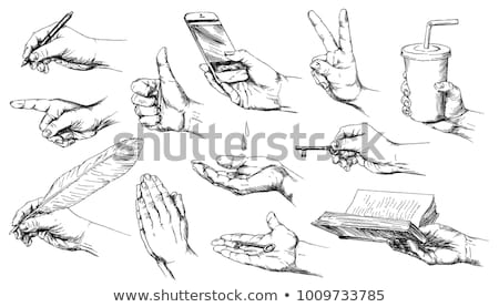 Stock photo: The male hands with a pen and the cup