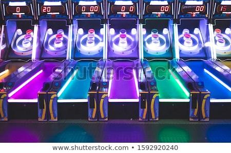 Arcade game machine in purple box Stock photo © bluering