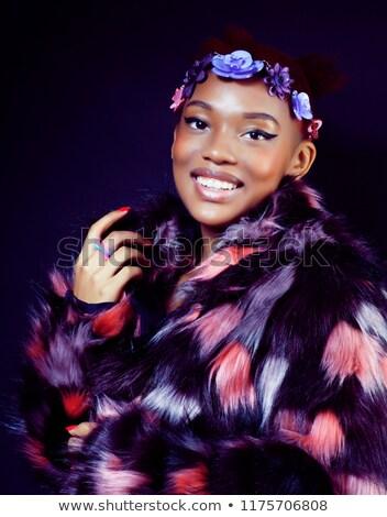 молодые · довольно · афроамериканец · женщину · шуба · цветы - Сток-фото © iordani