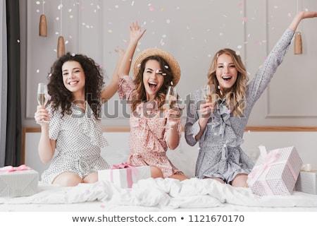 happy girls celebrating a bachelorette party of bride stock photo © yatsenko