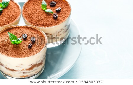 tiramisu on a red napkin on dark wooden background traditional stock photo © yatsenko