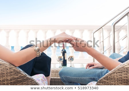 close up couple in love sitting on a mountain hugging and look stock photo © yatsenko