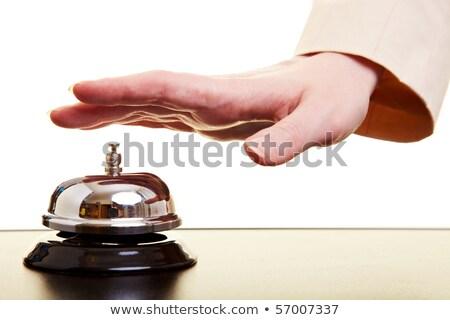 businesswoman ringing hotel reception bell stock photo © stevanovicigor